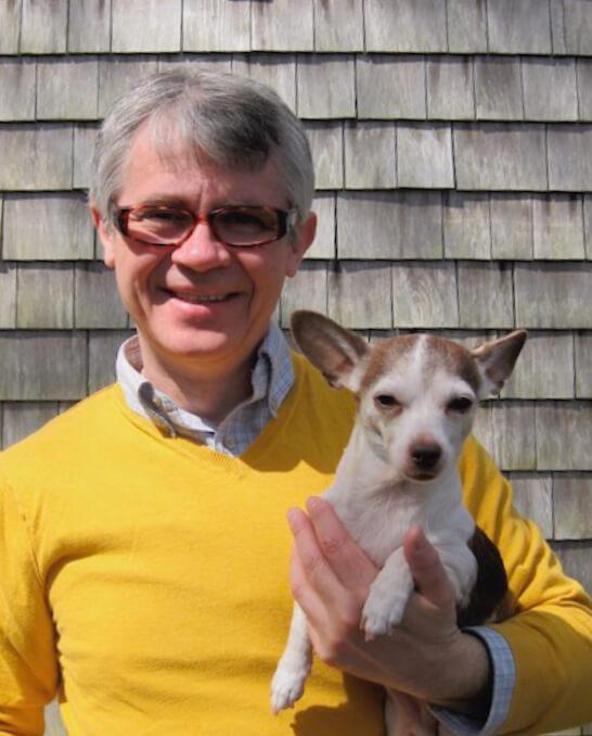 Dr. Paul Kotas, DVM, holding a chihuahua.